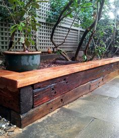 Recycled railway sleepers stained for a raised garden bed