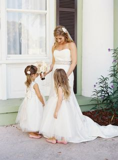 Flower girls admiring the Bride! Photography by Gina Leigh Photography