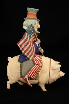 http://www.ebay.com/itm/Antique-German-Uncle-Sam-Nodder-on-Pig-Candy-Container-ca1910-/161666279706?