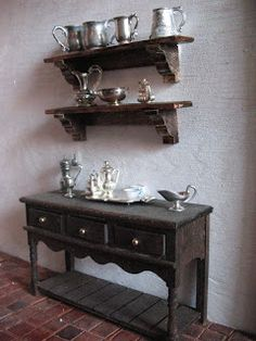 Thick shelves made from full-size wooden molding | Source: The Tudor (etc.) Dollhouse Project