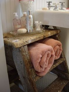 Old Wooden Step-Stool Ladder used as a table and shelf in the bathroom; nice reused item.
