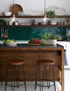 I love the wood and how it's tied in across the space. I also like the teal tile backsplash. Also the shelves seem very functional