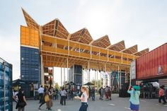 The four-storey structure is assembled from shipping containers and prefabricated elements.