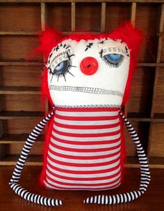 """Tinley the clownArt doll by Jen MusattoTinley measures: 11"""" tall , by 6"""" wide at her head, by 4"""" thick.ALL OF THE FACIAL FEATURES ARE MACHINE STITCHED. (ie: eye lashes, mouth, eyelids, nose, and any scars.)Each of my dollz are handmade with love using new or recycled clean fabric, buttons, and new polyfil. Each one is a one-of-a-kind creation, as I do not use a pattern. My dollz are handmade, cuddly works of art and therefore are not meant for chil..."""