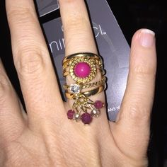 Beautiful Ring - size 7 This is brand new - 5 rings in one - last ring has cute dangling plastic pieces - size is 7 - nickel free - so in style - material is brass accented in gold Minicci Jewelry Rings