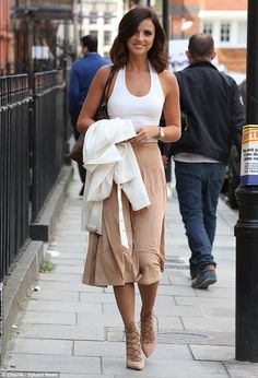 Dressed to impress: Lucy Mecklenburgh cemented her fashion-model status as she stepped out...