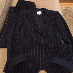 """Armani Pants Suit Almost perfect condition. There are marks on the sleeve cuff and one on the leg that I think would come out at a dry cleaner . 99% polyester  1% cupro and the lining is 109% viscoa . The pants are 40"""" long the inseam is 30"""" the bottom of the pants are 10"""" wide and the waist is 15"""" . The jacket is 23"""" long  17"""" across under the arms the sleeves from top of shoulder to bottom of cuff is 22"""". Armani  Other"""