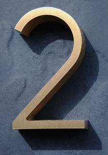 house numbers.  Love the style that is raised off the surface of the house (why can't I think of the style?!)