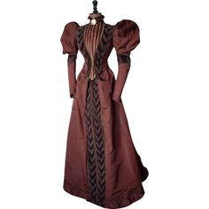 Elegant afternoon dress, made of chestnut satin, ca. 1895. The two piece dress imposed with the rich decoration with bands of brown velvet (or