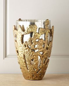 Attempt DIY! Use clay to create the outside around a vase, texture, bake, paint, and fit back around Mercury sprayed vase!