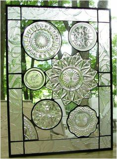 Beautiful window made from crystal & glass serving dishes & plates.