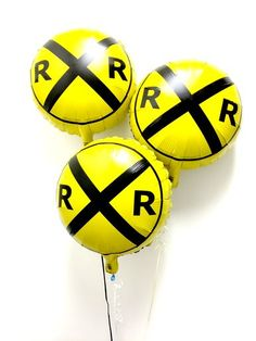 "Railroad crossing mylar (foil) balloons. The train balloon has a imprint of the popular """"RR"""" crossing road sign in the yellow color background. Makes an excellent room decor item for your little eng"
