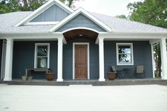 Exterior Columns | square white columns balance the dark blue house | Bayer Built Woodworks