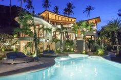 Modern curvy house with palm trees and pool