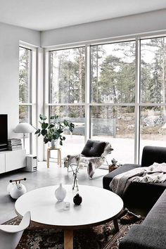 Home goals high ceilings and a garden view. Large windows with a view of the entire garden. Interiors | Monochrome Home In Finland