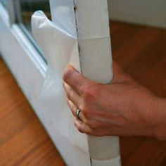 rubbing wax paper along the edges of a sticking door