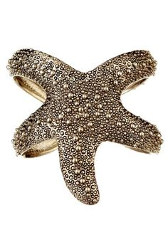 Starfish Cuff. I don't see one of these everyday and if it is heavy at $35 then it has my vote. So unique.