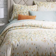 I like the Yellow  Organic Paint Palette Duvet Cover + Shams | west elm   Sheet Colors to match: Greys, light blues, whites.
