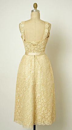 Christian Dior Couture evening gown dinner dress circa spring summer 1952. Made from ivory silk, cotton and lace. Fitted strap design top, separate full skirt and a matching belt. House of Dior. France.