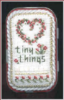 Free cross stitch design for the top of an Altoids tin