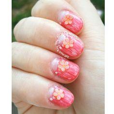Half moon orange nails with fimo cane slice flowers