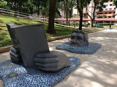 Very cool sculpture of the head and hands of a man reading - rising out of the sidewalk!