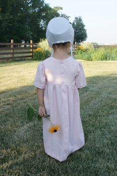 Flower for my momma.  Amish child.