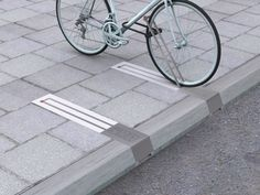 This unobtrusive bike rack takes up no space when there isn't a bike pinned to it. | 33 Ingeniously Designed Products You Need In Your Life