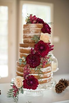 27 Naked Fall Wedding Cakes That Will Make Your Mouth Water: #2. Naked fall cake with marsala-colored dahlias