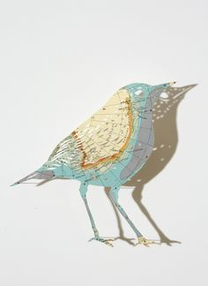 I come from the North - Claire Brewster uses old and out of date maps and atlases as her fabric with which to create her intricate, delicate and detailed cut outs, giving them incredible animal and plant shapes