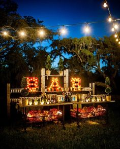 Illuminate the bar at a nighttime garden wedding. See more Totally Brilliant Garden Wedding Decoration Ideas Illuminate the bar at a nighttime garden wedding. See more Totally Brilliant Garden Wedding Decoration Ideas Rustic Backyard, Backyard Bbq, Romantic Backyard, Backyard Ideas, Backyard Signs, Rustic Outdoor Bar, Outdoor Buffet, Backyard Projects, Rustic Barn