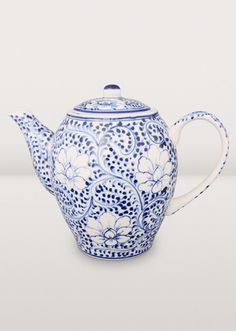 It's always a great time for tea with this regal blue and white ceramic teapot. Hand-painted with a lotus design by artisans in Vietnam, it's pretty, practical and a collector's piece too!