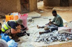 Jasyn Filming Traditional Miner who is crushing rocks which were mined from the traditional mines - looking for gold 2