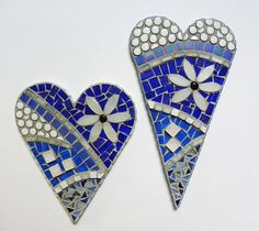 Mosaic heart handcrafted on 3/4 plywood using stained glass, tile, gems and metals. Wired and ready for hanging. This piece is 11 x 14 x 1 and is available to ship. Other sizes and color options are available. 7 x 9 x 1 $45 10 x 10 x 1 $95 Custom colors and sizes are available.