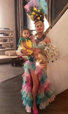 Celebrities dress up with their kids on Halloween Chrissy Teigen and daughter Luna Legend coordinated this Halloween. The cookbook author fittingly dressed as Carmen Miranda with her and John's baby girl dressing as a pineapple. Costume Carnaval, Carnival Costumes, Baby Costumes, Costumes For Women, Brazil Costume, Family Halloween Costumes, Halloween Kostüm, Mexican Halloween Costume, Chiquita Banana Costume