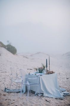 """""""The misty early evenings are legendary for the romantic atmosphere they create. So it was that the surroundings became the canvas for the decor concept of our blue and pewter beach wedding shoot."""""""