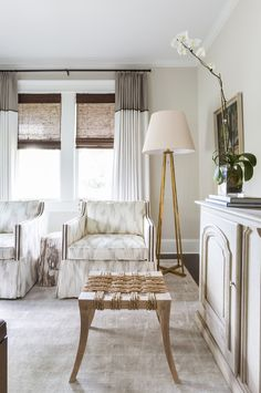 A neutral living room with fun prints and textural pieces is a goo way to make neutrals anything but boring.