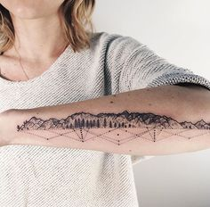 Simplistic mountain tattoo with geometric shadow