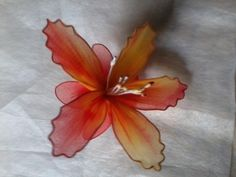 Make this lovely lily with stretchy mesh fabric - http://www.beadandcord.com/clipper/vannie/list/diy-fabric-lily-flower-18434.html