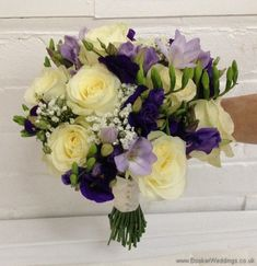 Purple and cream wedding flower Bridal Bouquet with ivory avalanche roses, purple lissianthus, lilac freesia and gypsophila Tilted View. Cream Wedding, Ivory Wedding, Rose Wedding, Purple Wedding Flowers, Wedding Colors, Bride Bouquets, Bridesmaid Bouquets, Cream Flowers, Side View