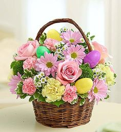 Easter Egg Basket: Send Easter smiles by the basketful! We've taken the freshest blooms in pastel shades of pink, yellow and purple, and gathered them together inside a rustic handled basket. #holidays #floral #bouquets #flowerarrangements #beautiful #nancysfloral #love #flowers #Gresham #Oregon #flowerpower #Easter
