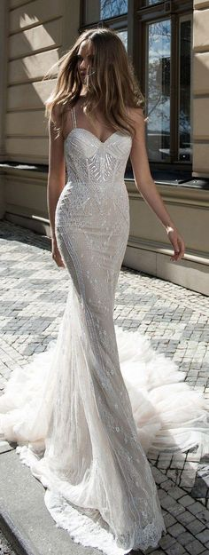 A delicate trumpet wedding gown with a little bling is a sexy choice for a bride looking to show off her figure on her wedding day.