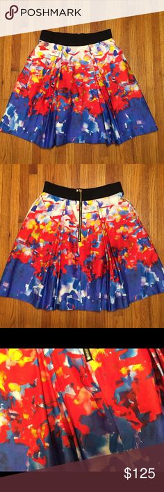 """Milly A-Line Skirt Milly a-line skirt. Elastic waist w/ exposed back zip; box pleats, impressionist pattern. Cotton skirt, lined. 20"""" long. Exceptional condition. Size 6. Milly Skirts A-Line or Full"""