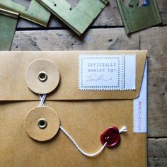 Beautifully designed KRAFT envelope with a string closure. It's perfect to keep small and precious items or use it as a gift package! You can also place these envelopes in your notebook with double si