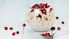 Chia seed parfait made with pomegranate, oats and almonds with extreme shallow depth of field.