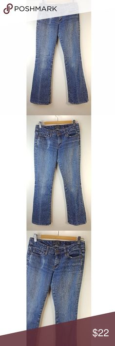 SEVEN7 flare medium wash denim Jeans Pants Size 28 Women's Seven7 medium wash jeans in size 28. They are in good condition minus some wear on bottom leg openings.   Measurements are provided to ensure fit. Compare my measurements with your favorite/best fitting jeans for the perfect fit!  Waist: Approximately 14 inches across. Hips: Approximately 18 3/4 inches across. Front rise: Approximately 7 1/2 inches. Inseam: Approximately 31 1/2 inches. Length of leg: Approximately 39 1/2 inches top…