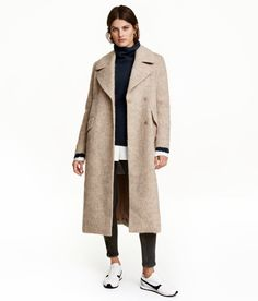 Light beige melange. Calf-length coat in a thick wool-blend fabric. Wide, notched lapels, concealed double row of buttons at front, front pockets with flap