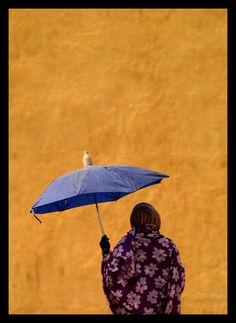 Woman protecting from the sun with an umbrella, Mendefera, Eritrea