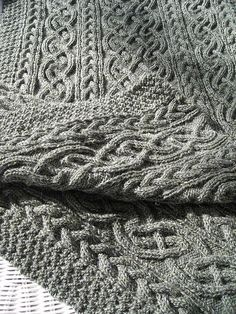 Yes, more beautiful cables! St. Brigid pattern. This gorgeous grey is by Knitterbay2. Beautiful work! http://www.flickr.com/photos/23496596@N06/2506546200/lightbox/