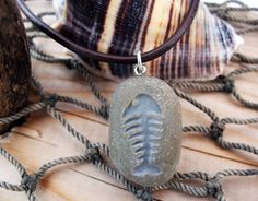 Wishin' on a Fishbone  engraved Beach Stone Pendant  by castastone, $24.99
